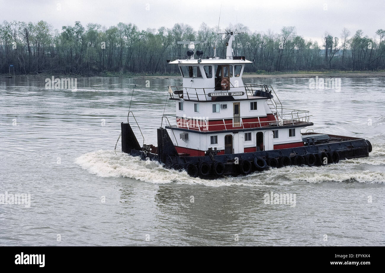 A type of towboat called a pusher, pusher boat or pusher tug is used to push cargo barges on the Mississippi River - Stock Image