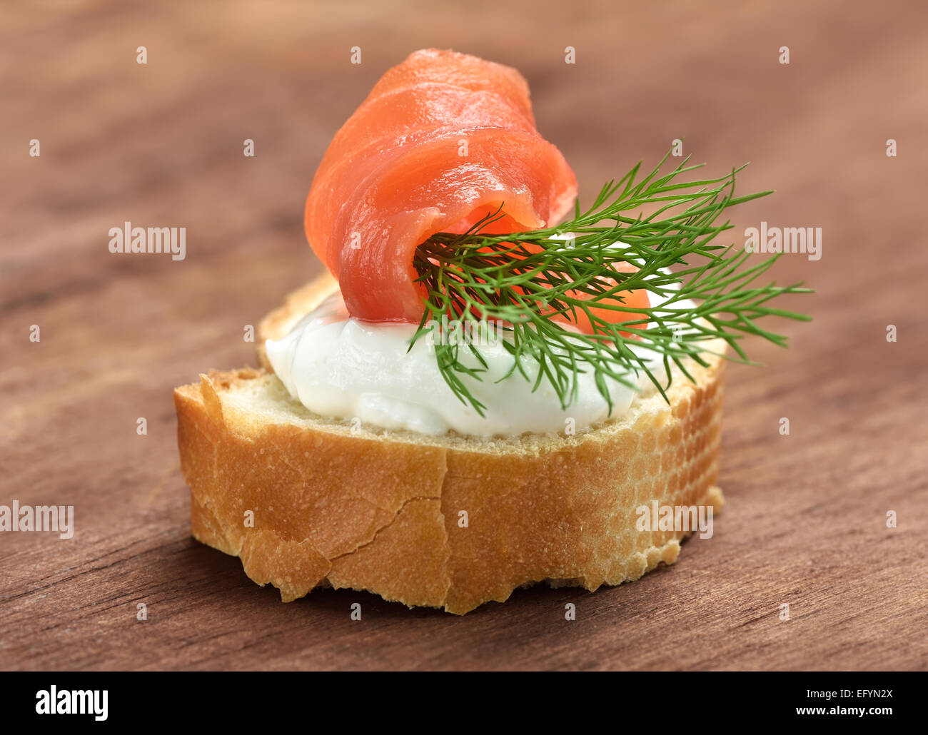 Appetizer with salmon and dill, close up view - Stock Image