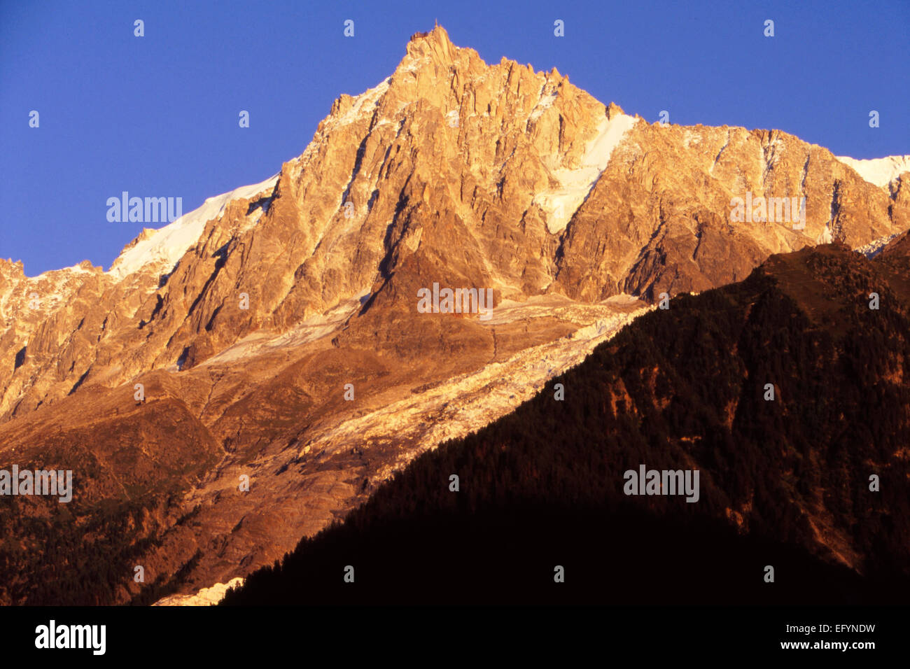 Aiguille du Midi in summer time with glacier Rond in sunset glow Stock Photo