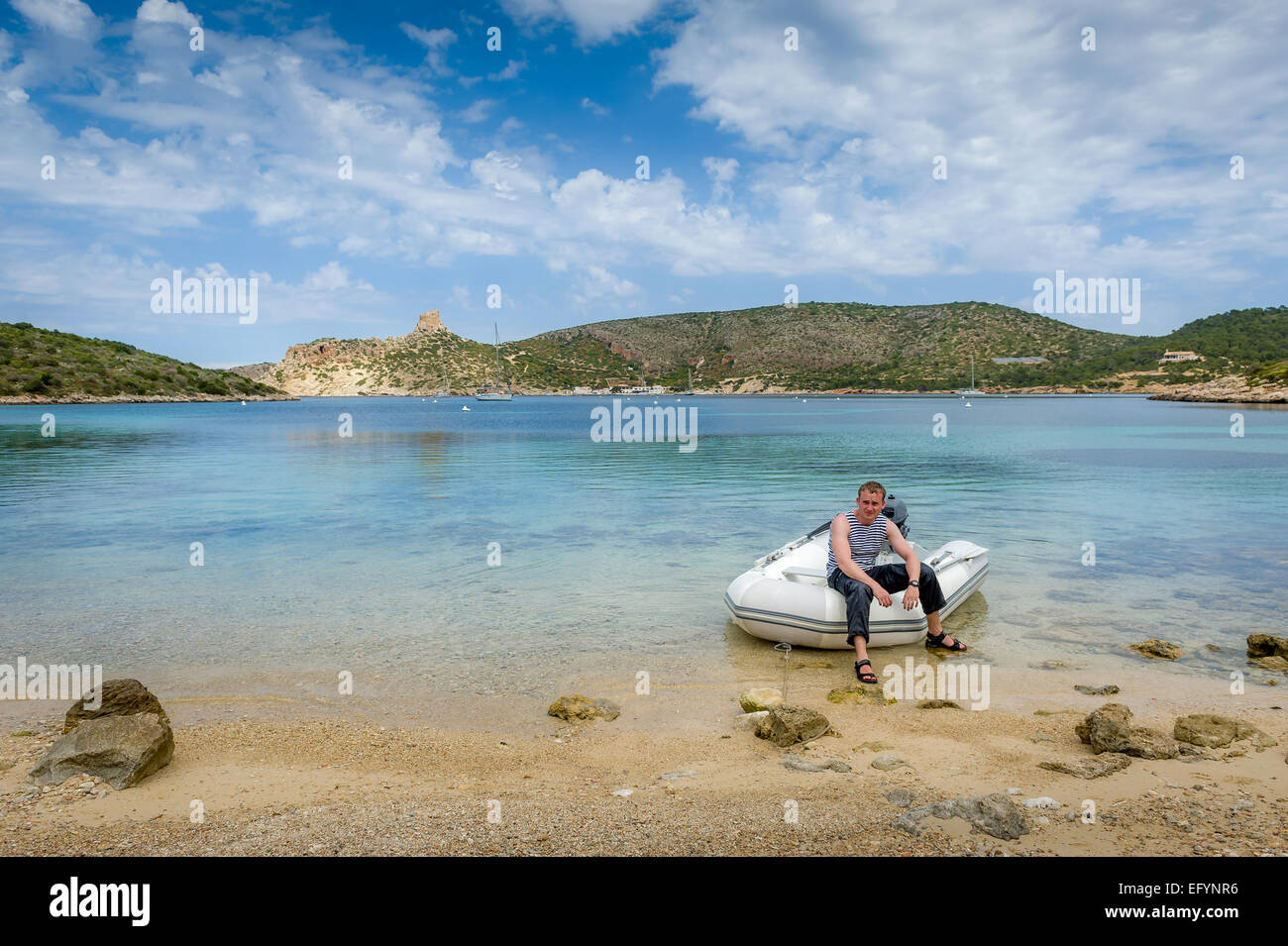 Sailor in dinghy - Stock Image