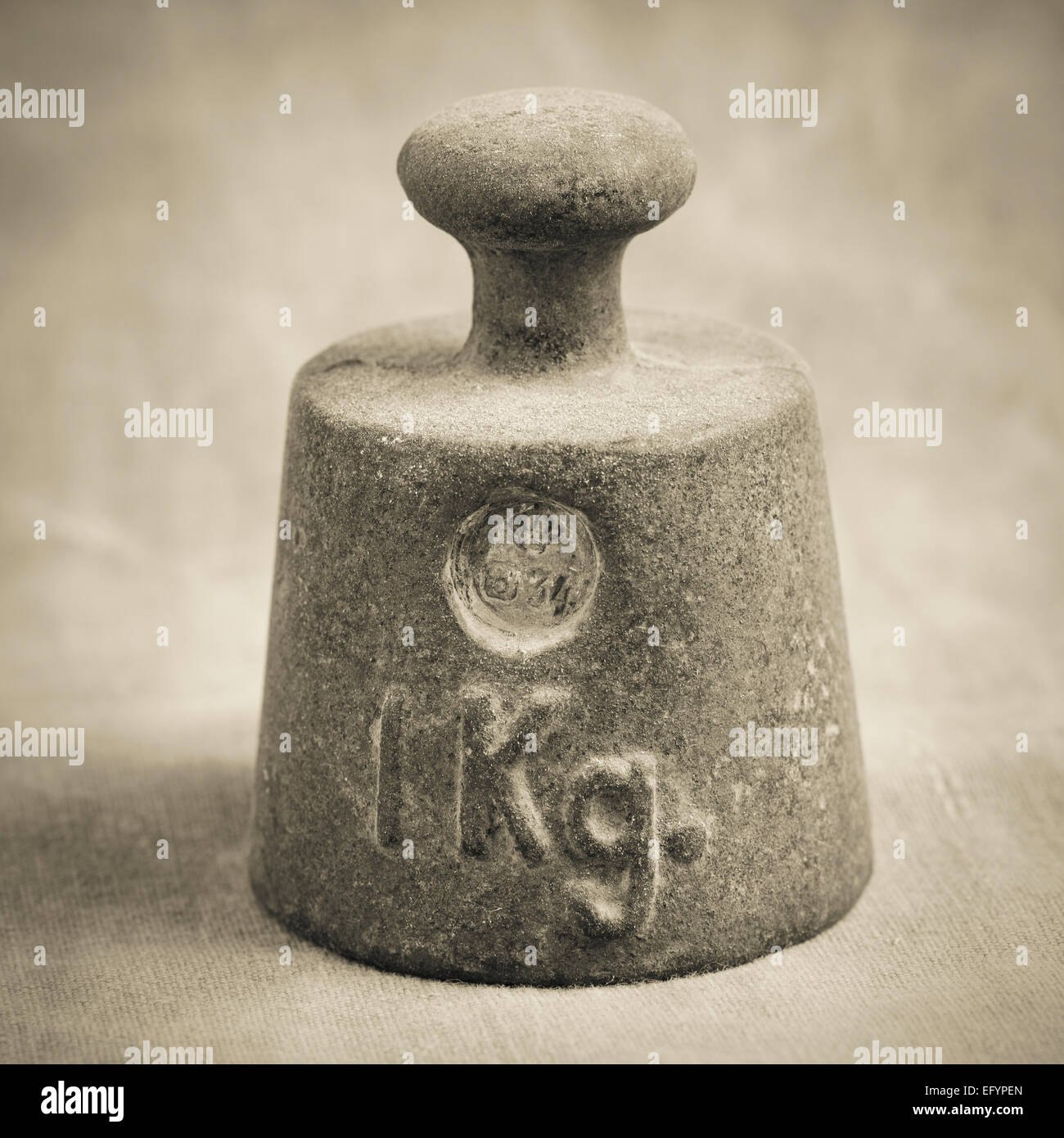 Still life of old fashioned iron weight of one kilogram used for measurement - Stock Image