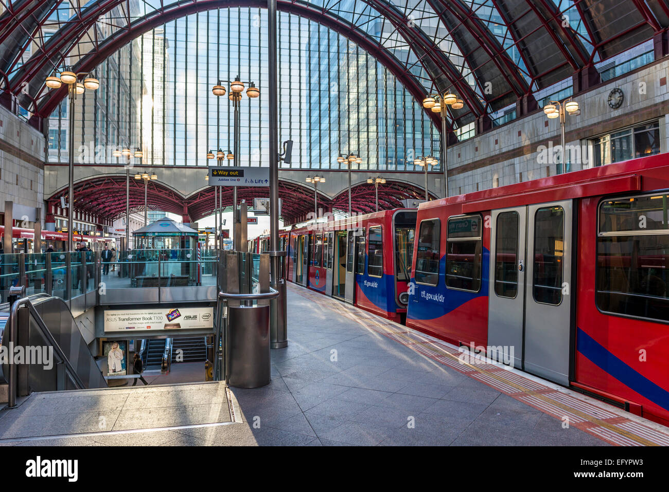 The Docklands Light Railway (DLR) station at Canary Wharf, London's second financial and business district - Stock Image