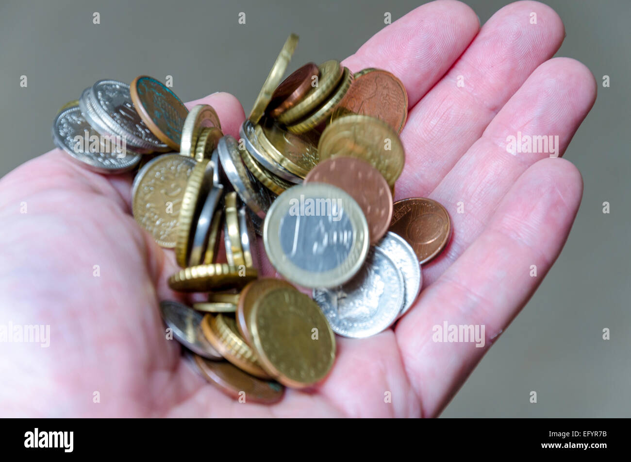 Euro coins in hand - Stock Image