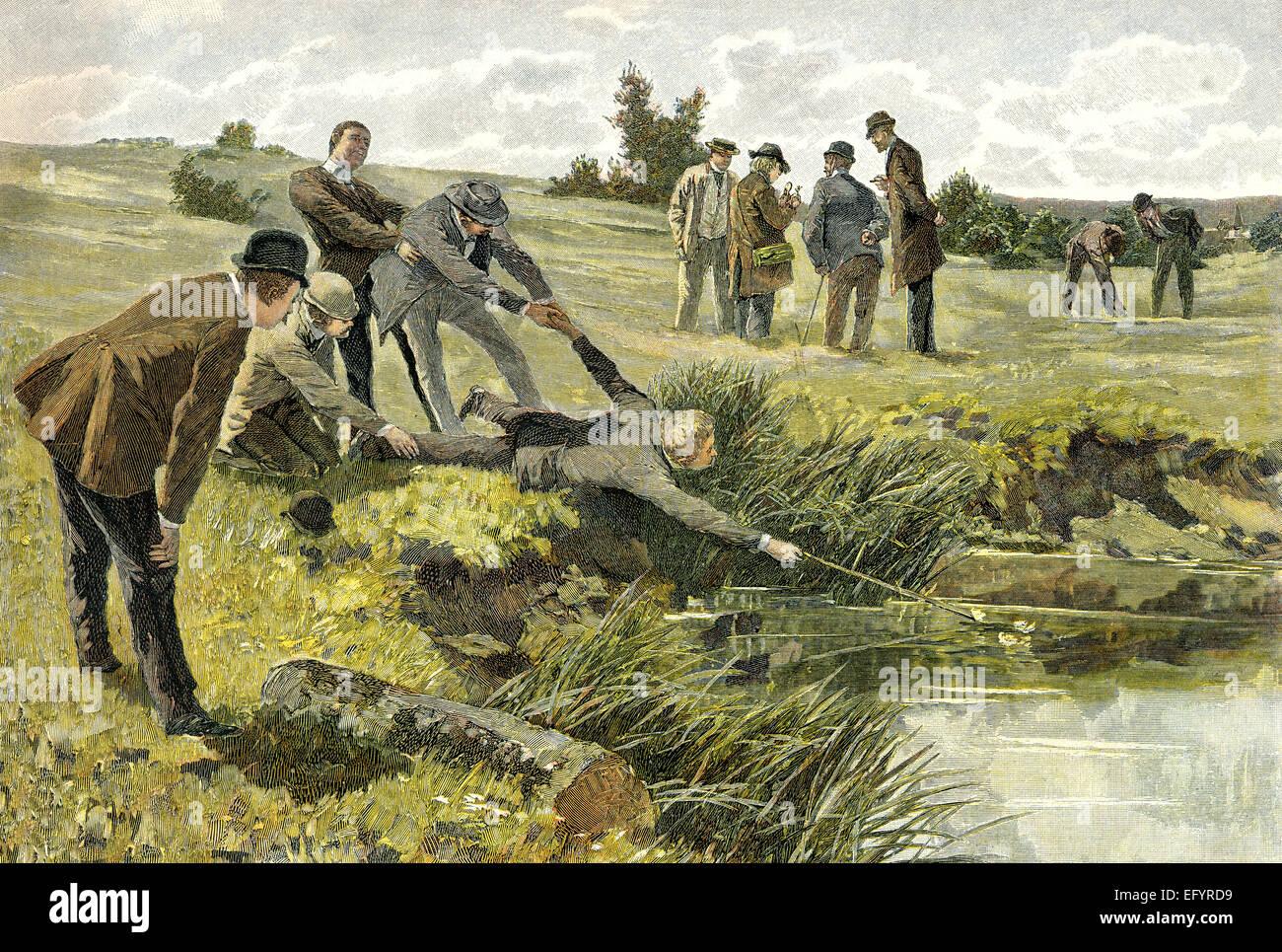 a man trying to get a rare plant from a pond, c. 1895, by Hey, ein Mann versucht eine seltene Pflanze aus einem - Stock Image