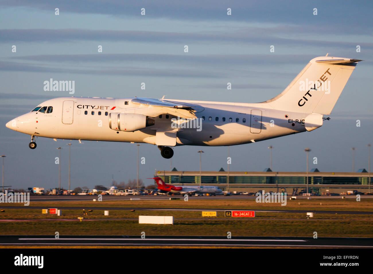 CityJet British Aerospace RJ85 approaches runway 28 at Dublin airport. - Stock Image
