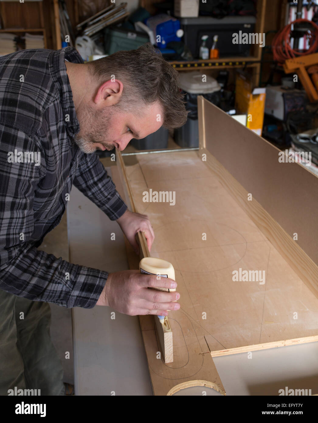 Man constructing woodworking project - Stock Image
