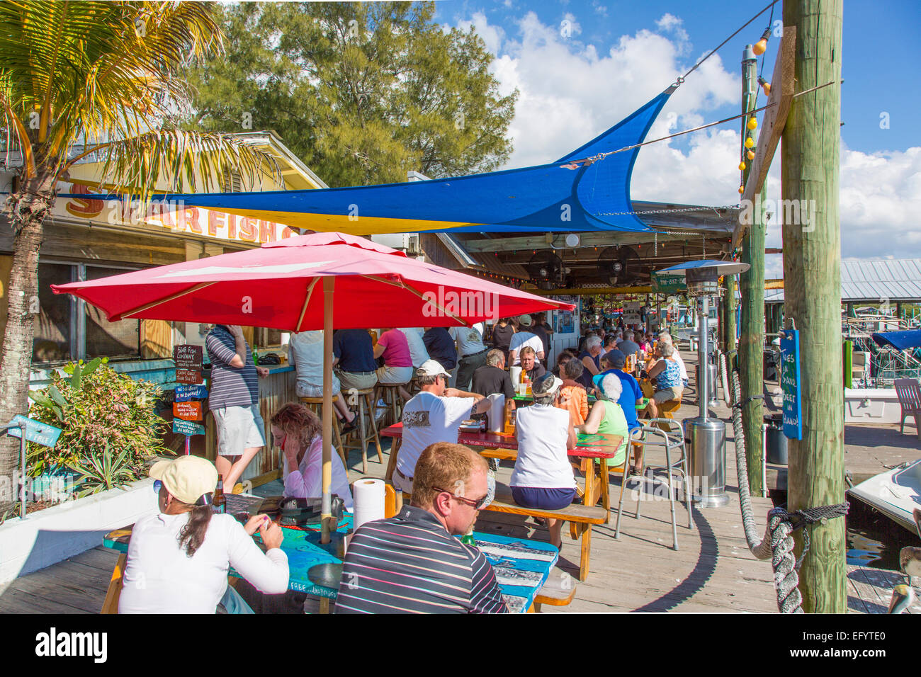Outdoor dinning on the dock at Star Fish Company Dockside Restaurant in Cortez Florida - Stock Image
