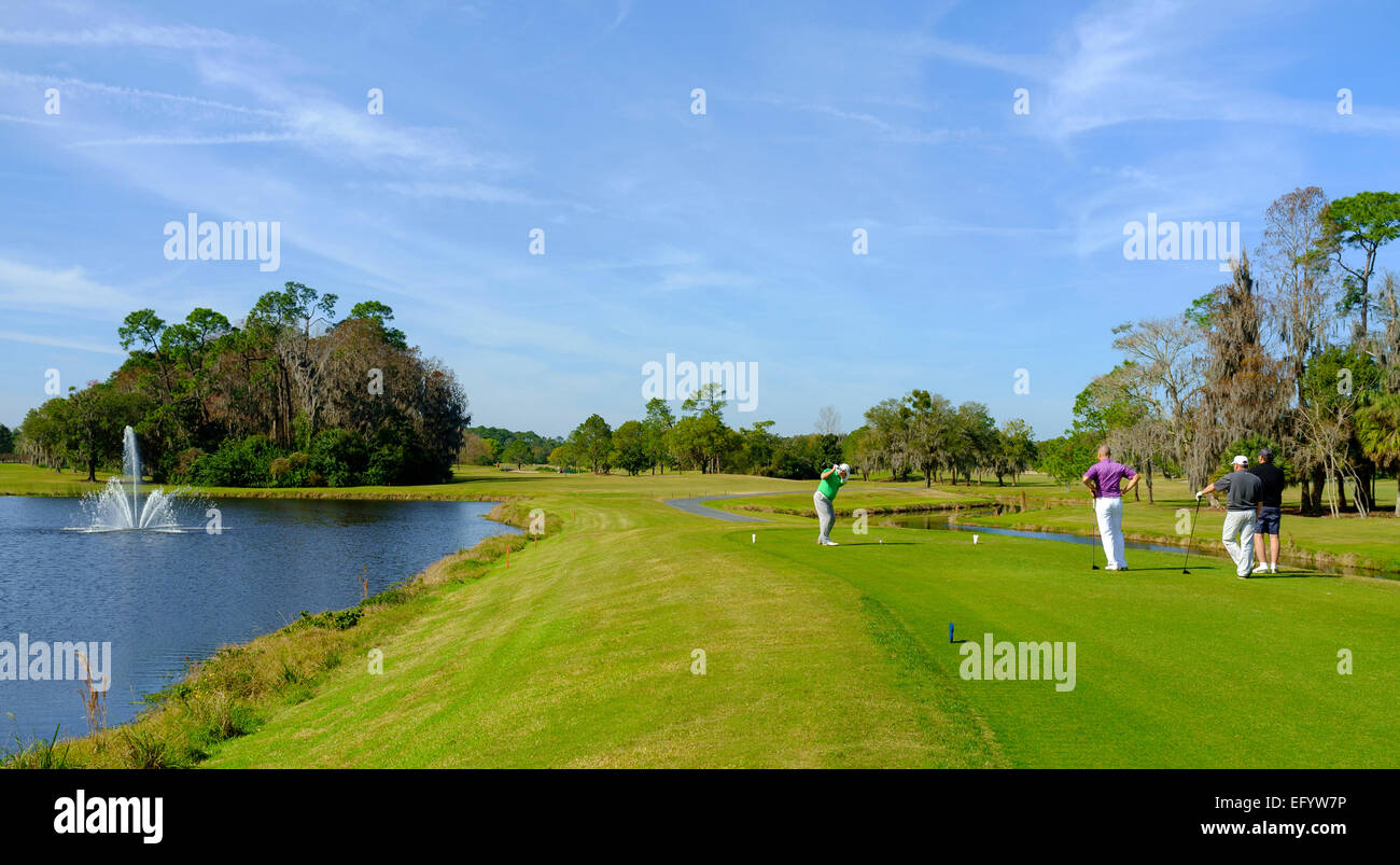 Tenth tee and fairway with golfers at the Magnolia Golf Course, lake Buena Vista, Orlando, Florida - Stock Image