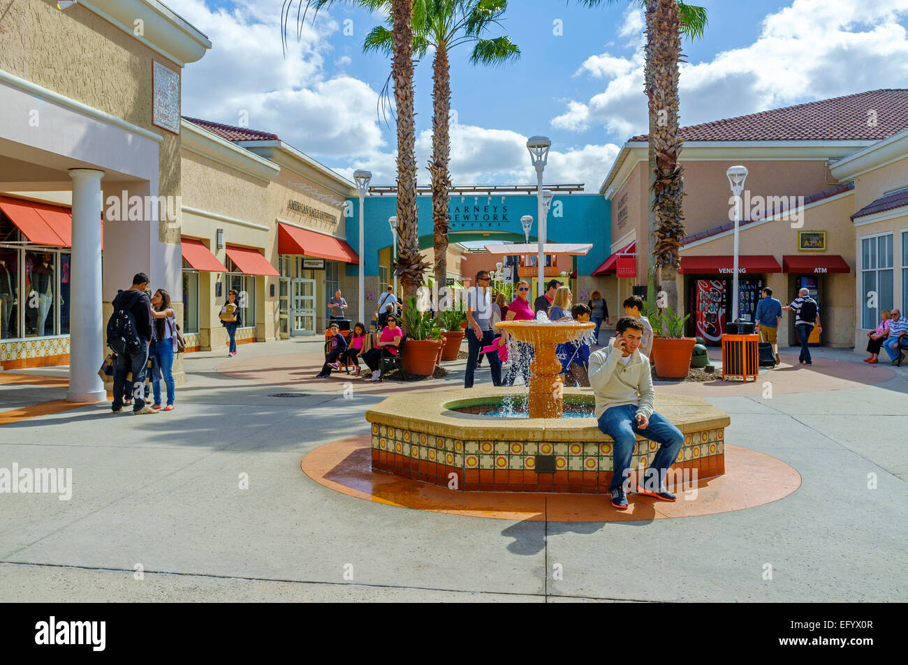 Shoppers outside at the Orlando International Premium Outlets shopping Mall, International Drive, Orlando, Florida, - Stock Image