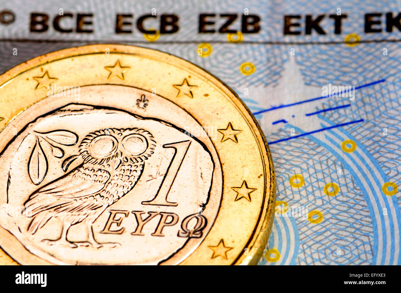 Greek 1 Euro coin on a €5 note - Stock Image