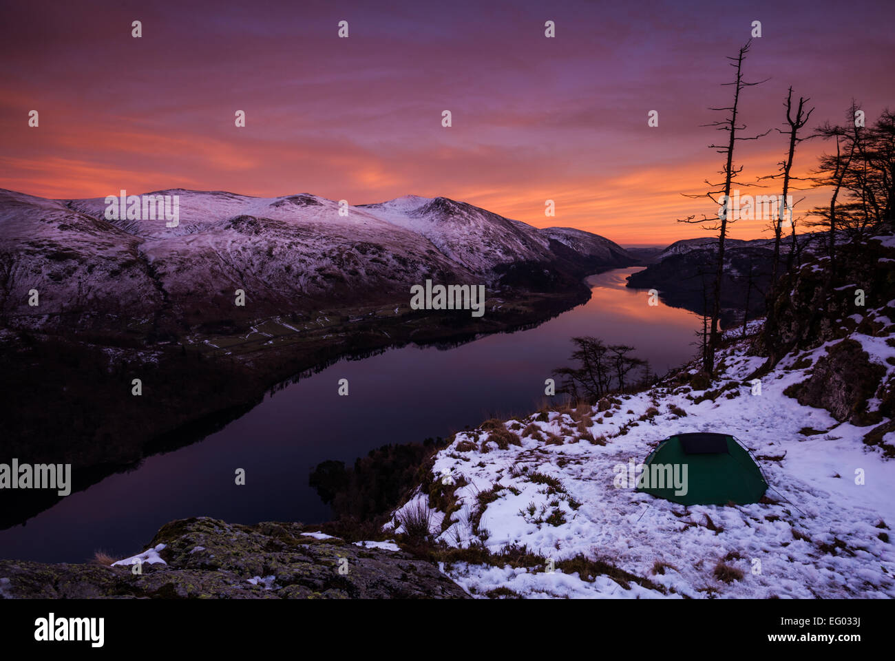 Wild camp tent at twilight after a beautiful pink sunset at Raven Crag, Lake Thirlmere in the English Lake District. - Stock Image