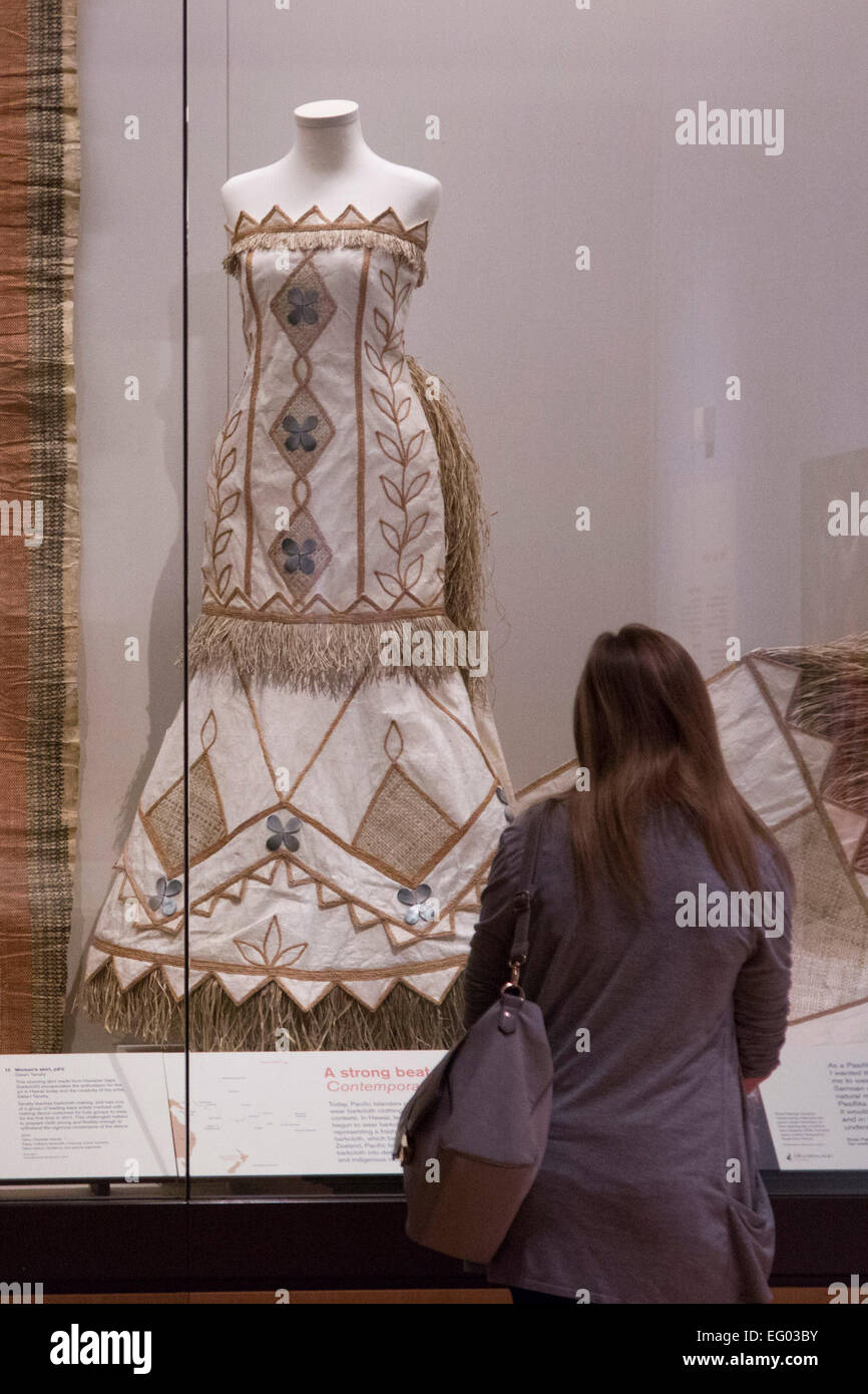 A Visitor To The Exhibition Looks At A Wedding Dress Made Of Stock