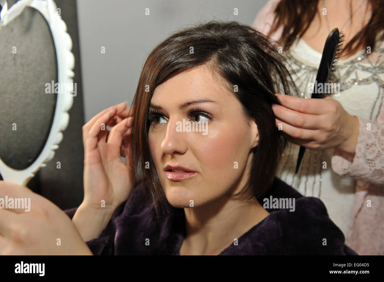 Hair dresser prepares a bride for her wedding. - Stock Image