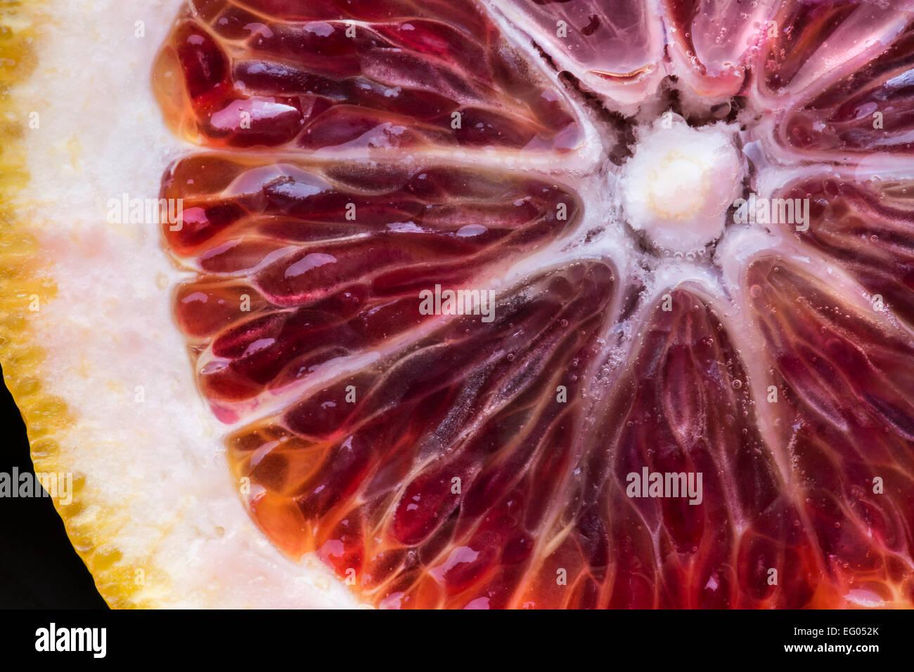 Very close detail of blood orange flesh. - Stock Image