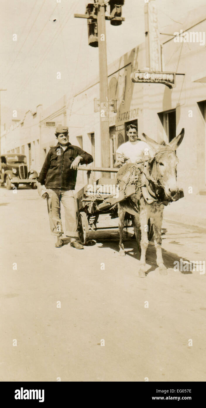 Usa. 12th Dec, 2014. CIRCA 1930s: Reproduction of an antique photo shows two men posing beside the wagon, which Stock Photo