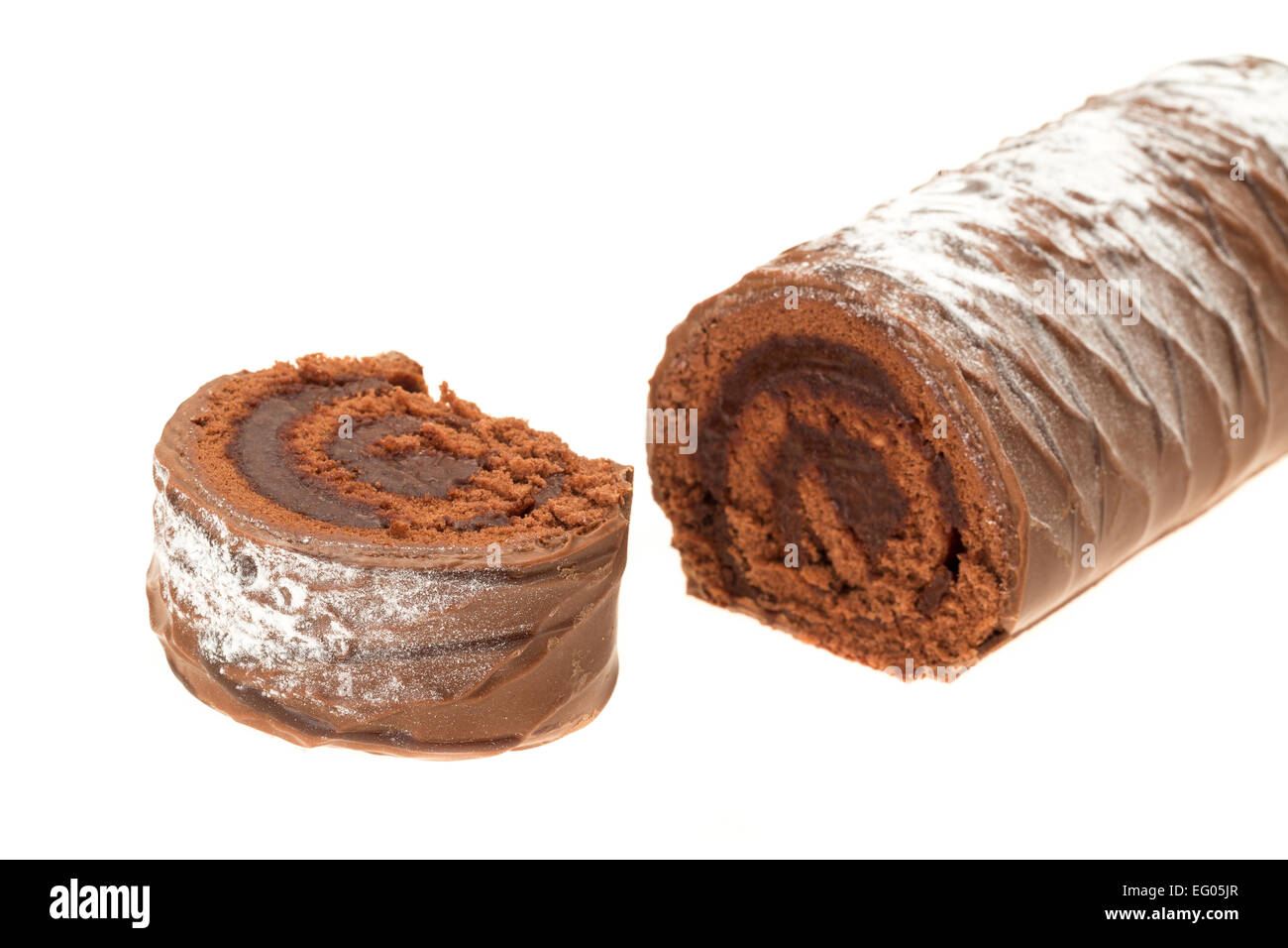 A chocolate coated yule log - studio shot with a white background - Stock Image