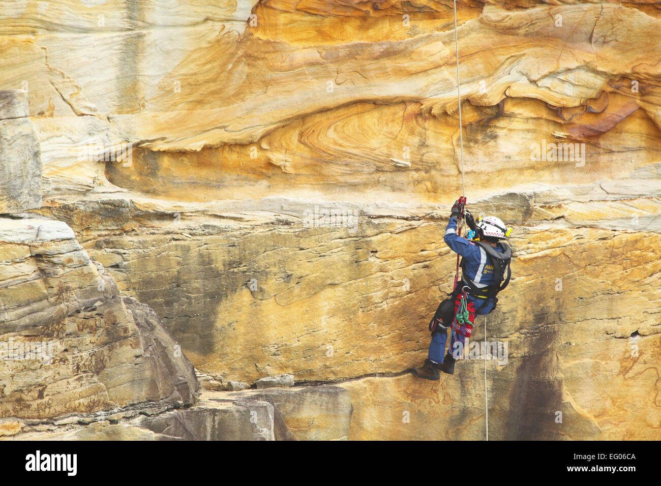 A male member of the Special Operations team, within the Ambulance Service of NSW, conducts abseiling and rappelling - Stock Image