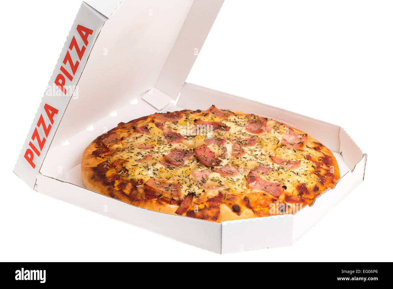 Take out box of a pineapple and ham Hawaiian pizza - studio shot with a white background - Stock Image