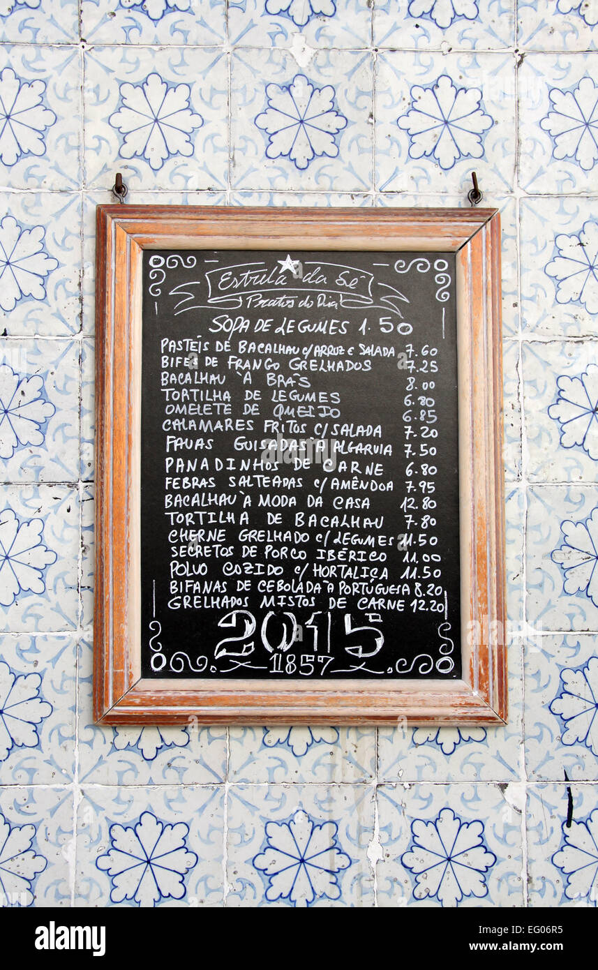 Cafe menu mounted on a tiled wall in the Alfama district of Lisbon - Stock Image