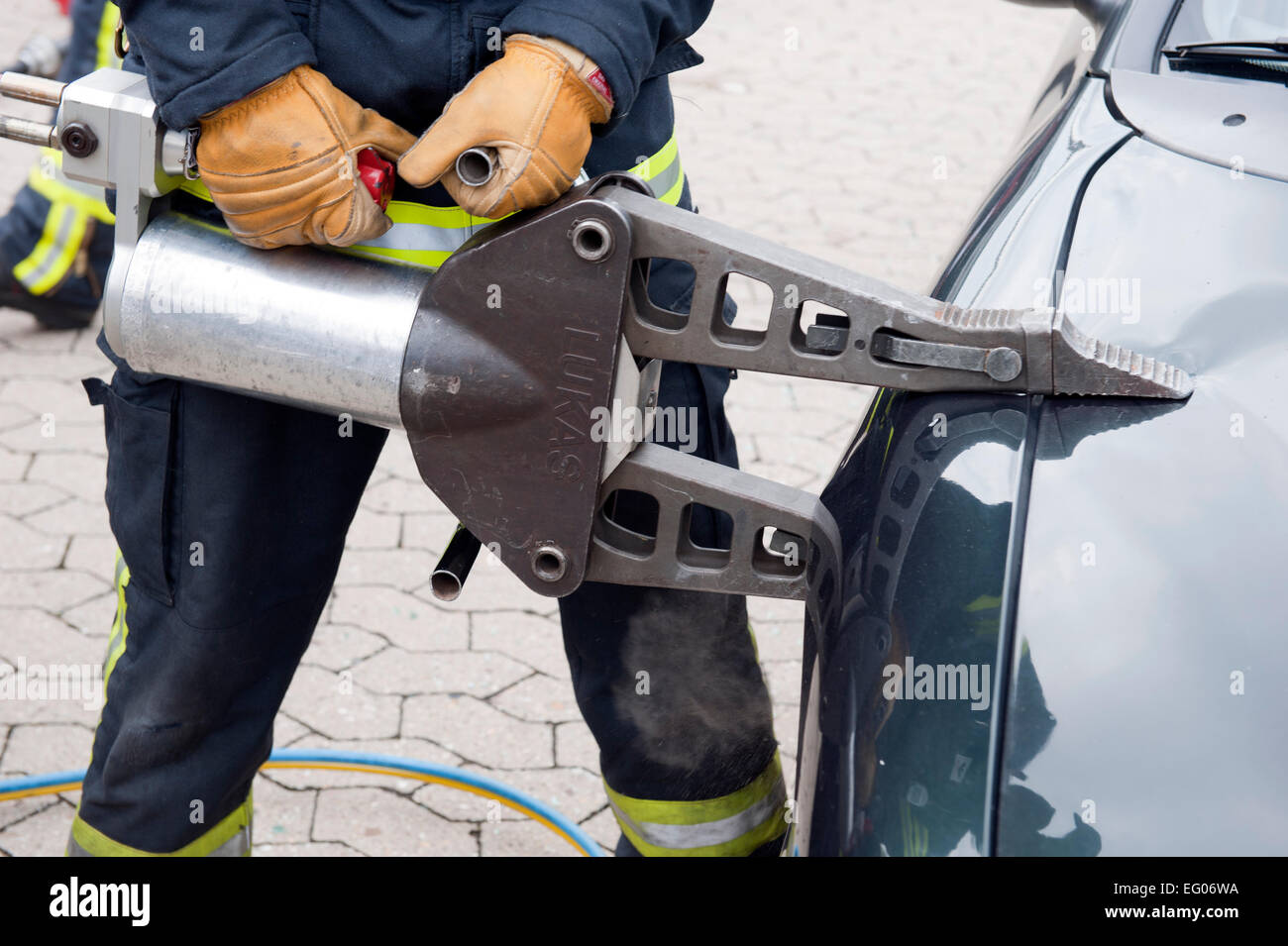 Hydraulic cutter firebrigade at work at a fender wing of a car germany - Stock Image