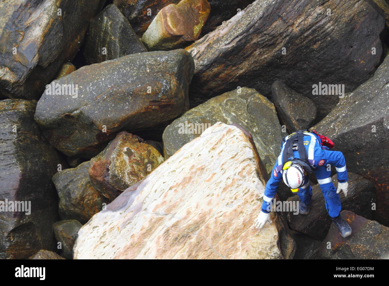 A male member of the Special Operations team, within the Ambulance Service of NSW, conducts search and rescue training. - Stock Image