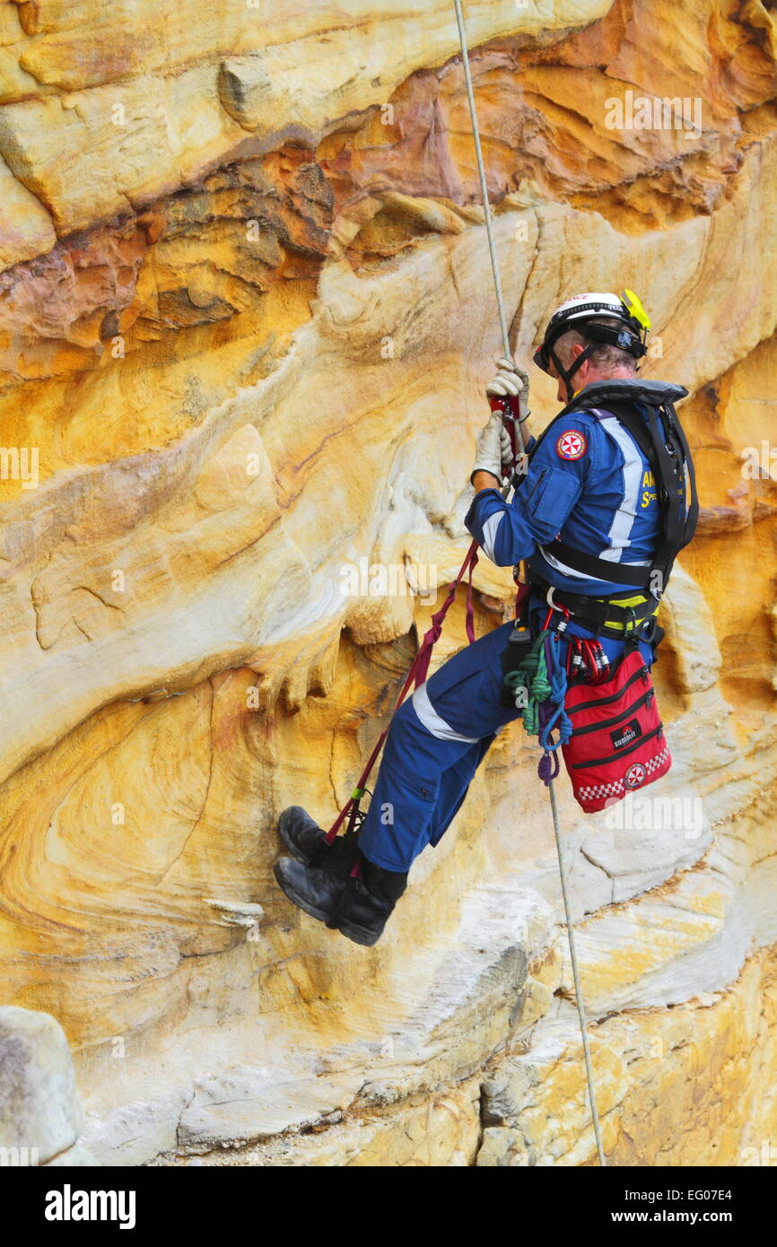 A male member of the Special Operations team, within the Ambulance Service of NSW, conduct abseiling and rappelling - Stock Image
