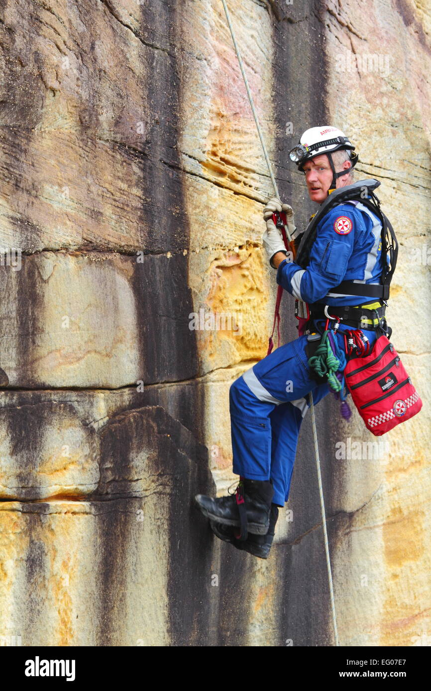 A male members of the Special Operations team, within the Ambulance Service of NSW, conduct abseiling and rappelling - Stock Image