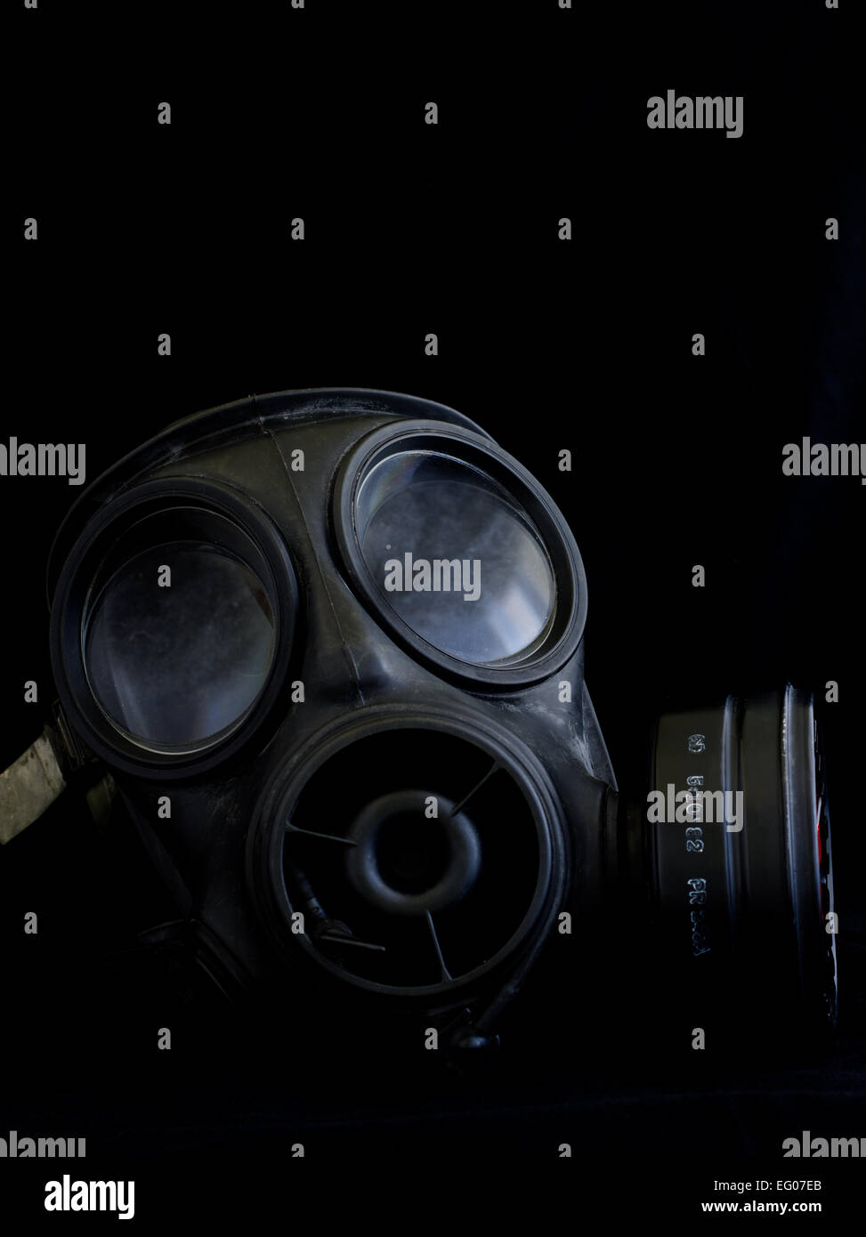 gas mask respirator on black background - Stock Image