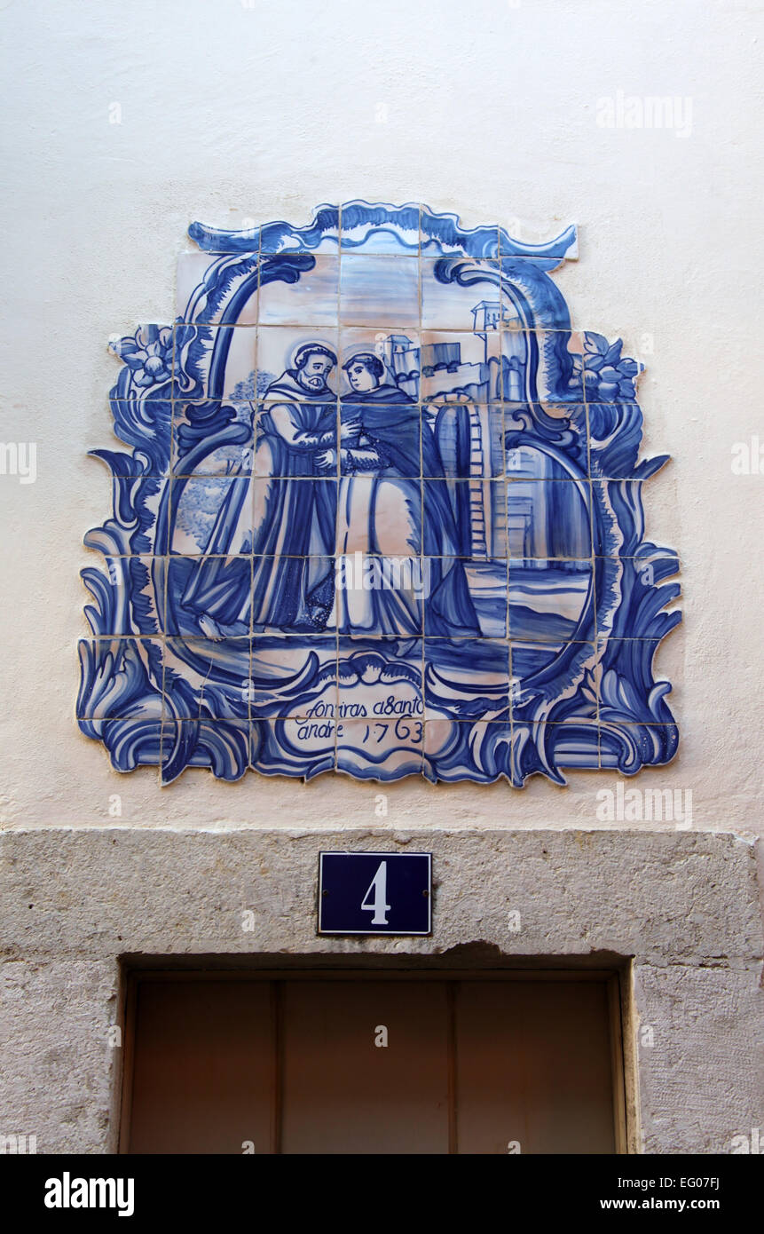 Glazed tiles dated 1763 on the exterior of a house in the Alfama district of Lisbon - Stock Image