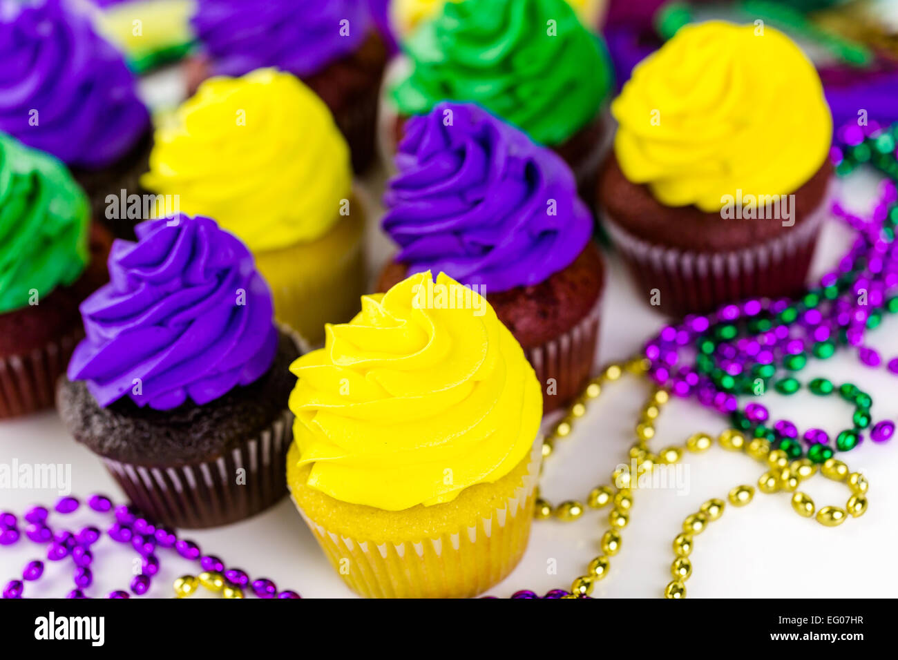 Cupcakes decorated with bright color icing for Mardi Gras party ...