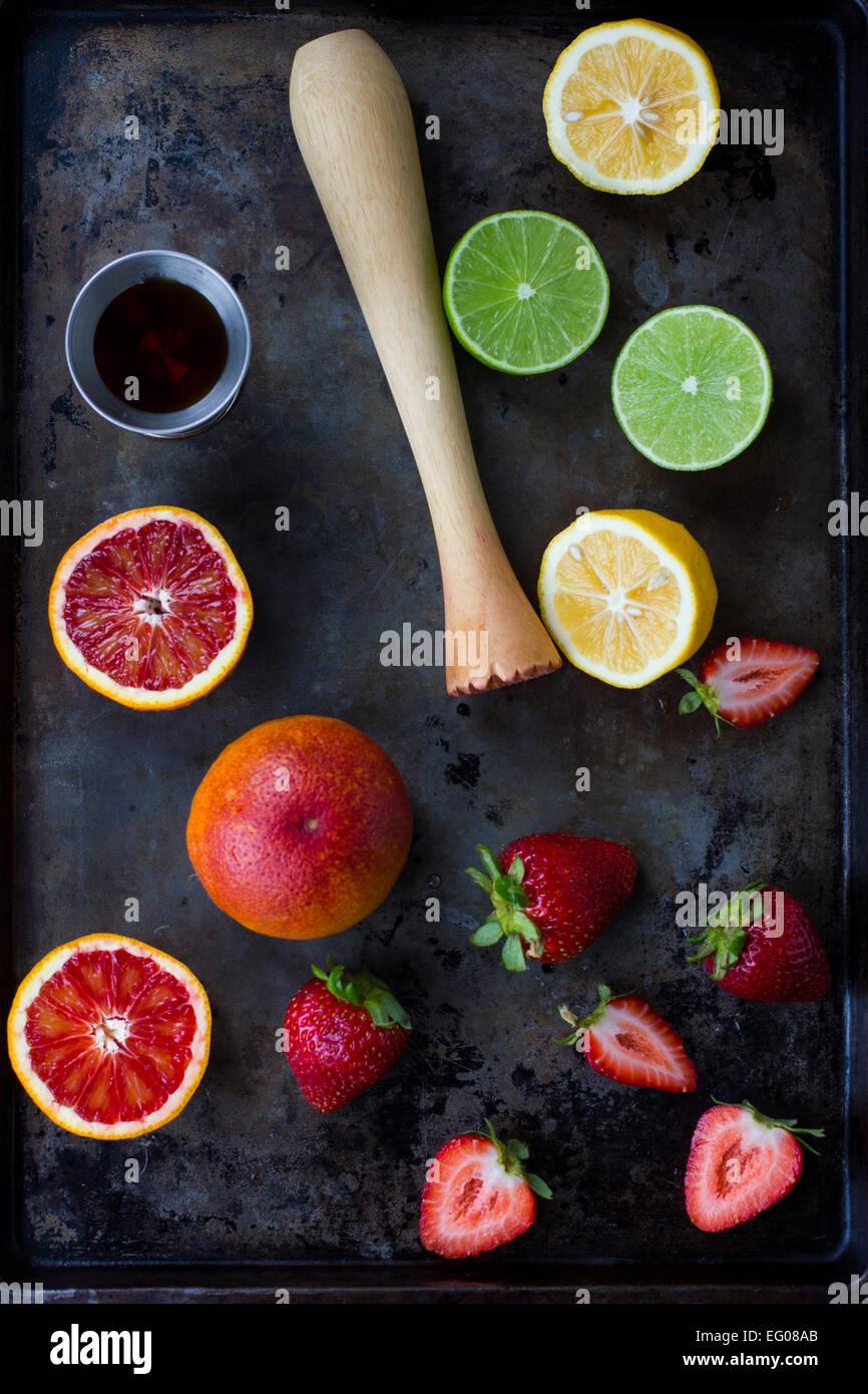 Blood orange, lemon, lime and strawberries on a baking tray - Stock Image