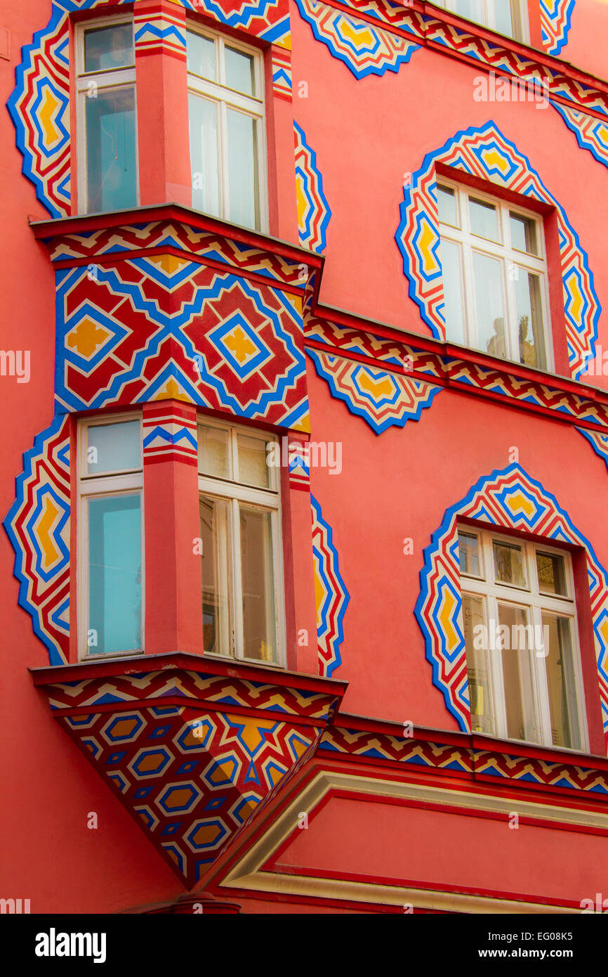 Windows on a red palace in the center of Ljubljana - Stock Image