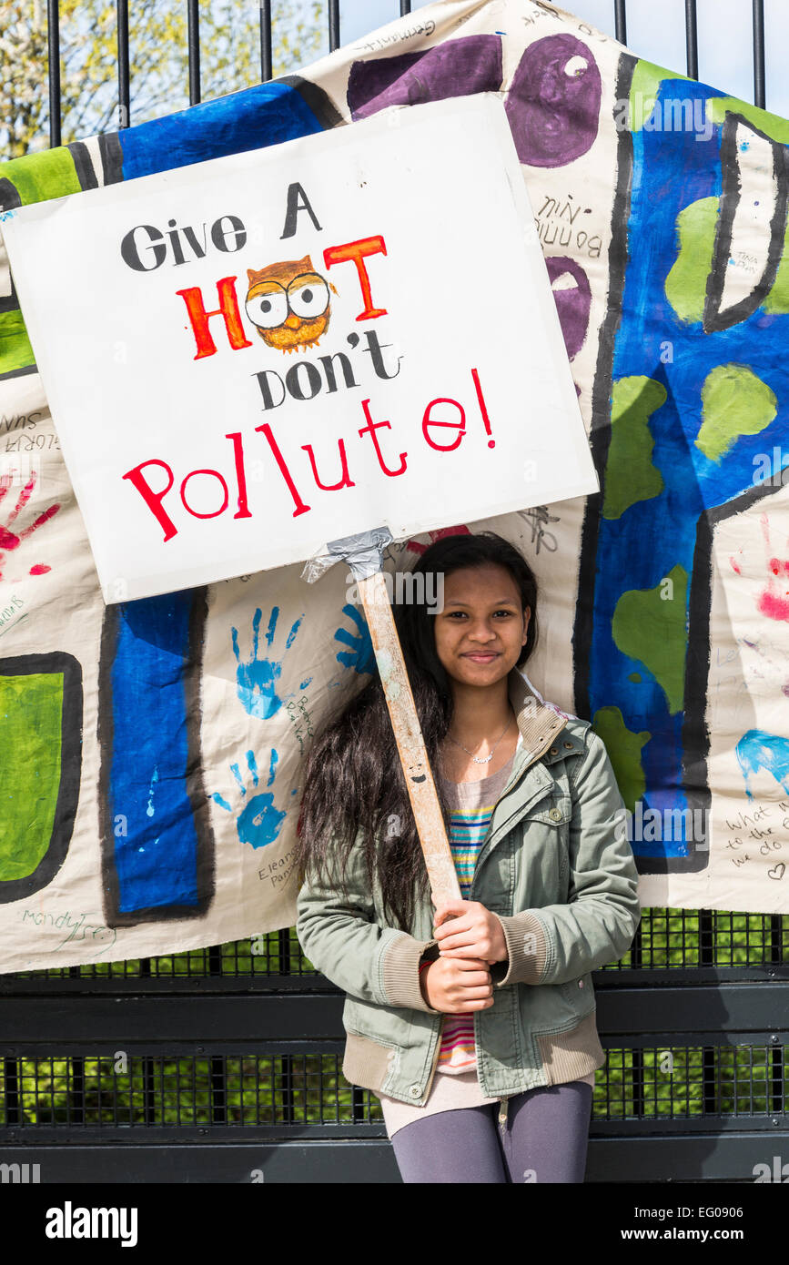 Young Asian woman with protest sign, Vancouver Earth Day Parade and Festival 2013, organised by 'Youth for Climate - Stock Image