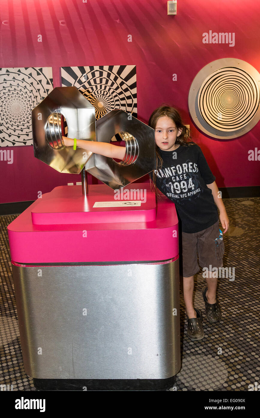 Boy interacting with optical illusion display at Telus, World of Science, Vancouver, British Columbia, Canada (model - Stock Image