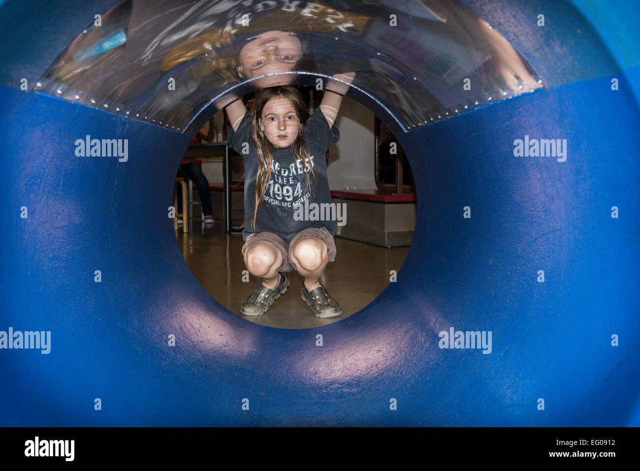 Boy interacting with display at Telus, World of Science, - Stock Image