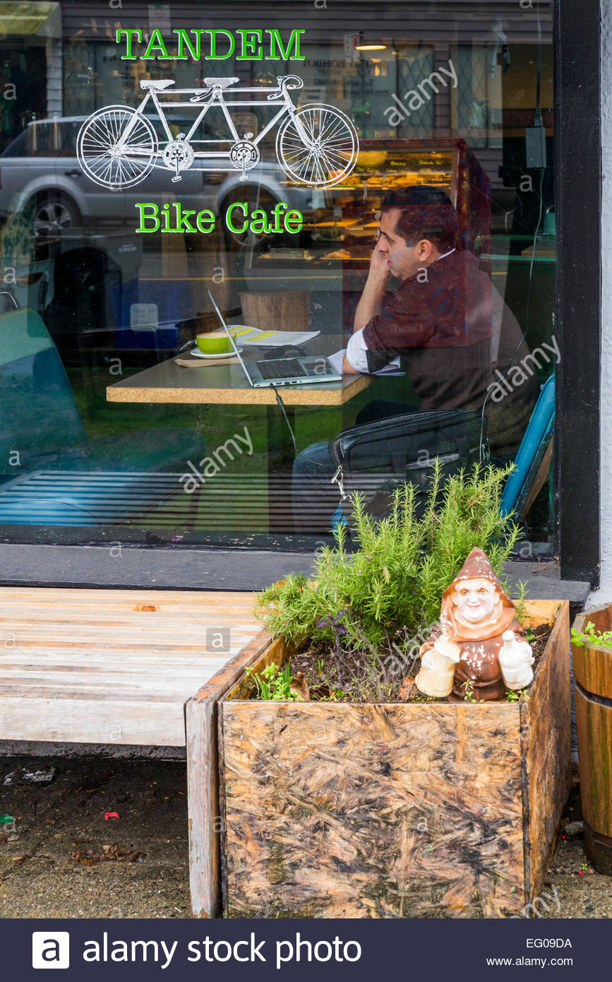 Man in Tandem Bike Cafe, Vancouver, British Columbia, Canada - Stock Image