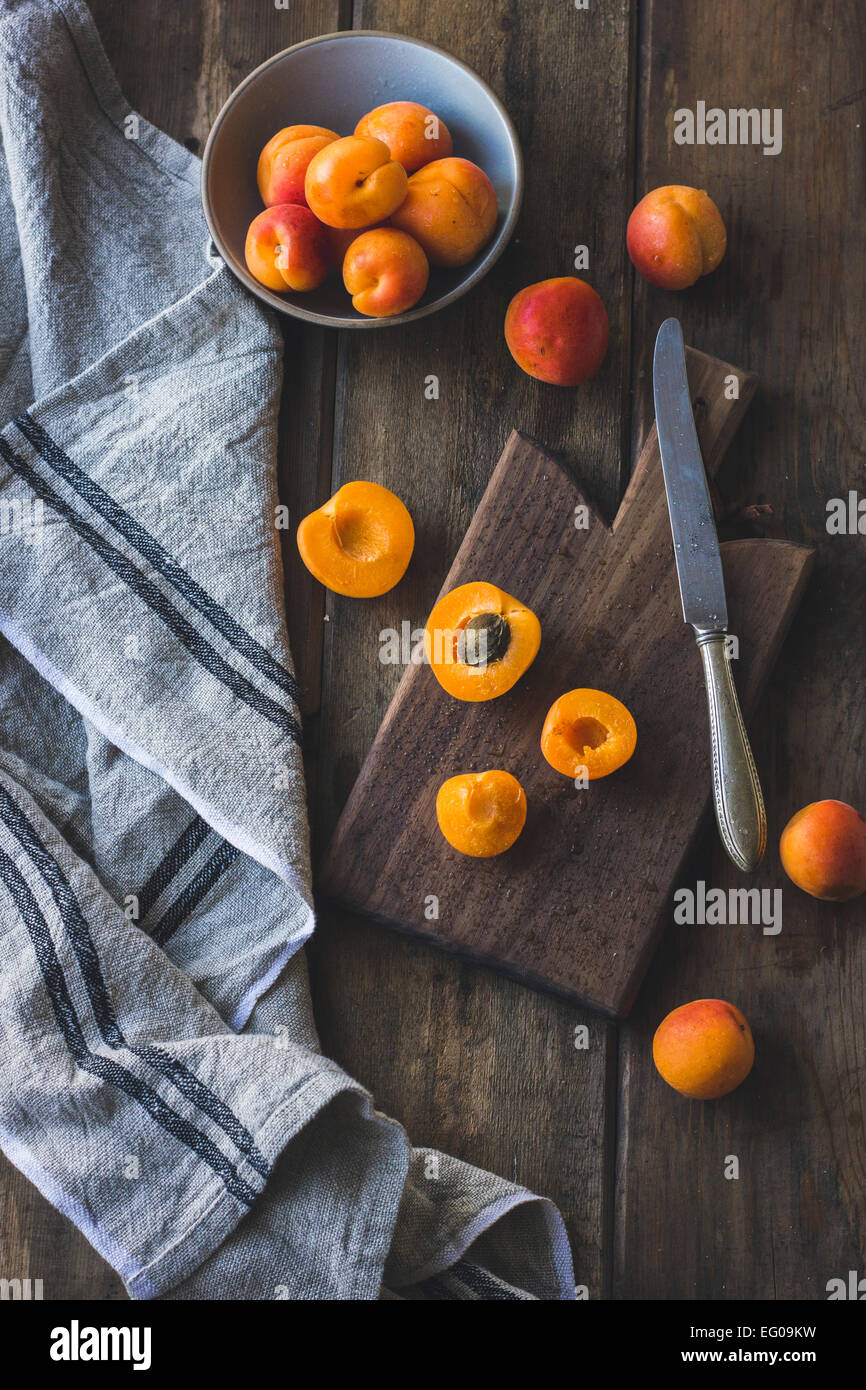 Apricots on a wooden board - Stock Image