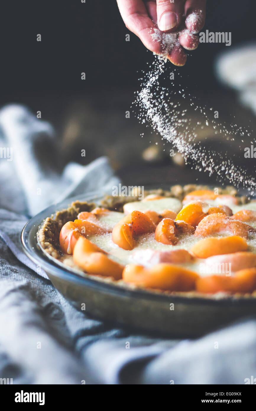 Apricot custard tart with crumble crust dessert - Stock Image