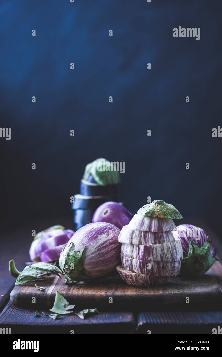Eggplant, aubergines on a cutting board - Stock Image