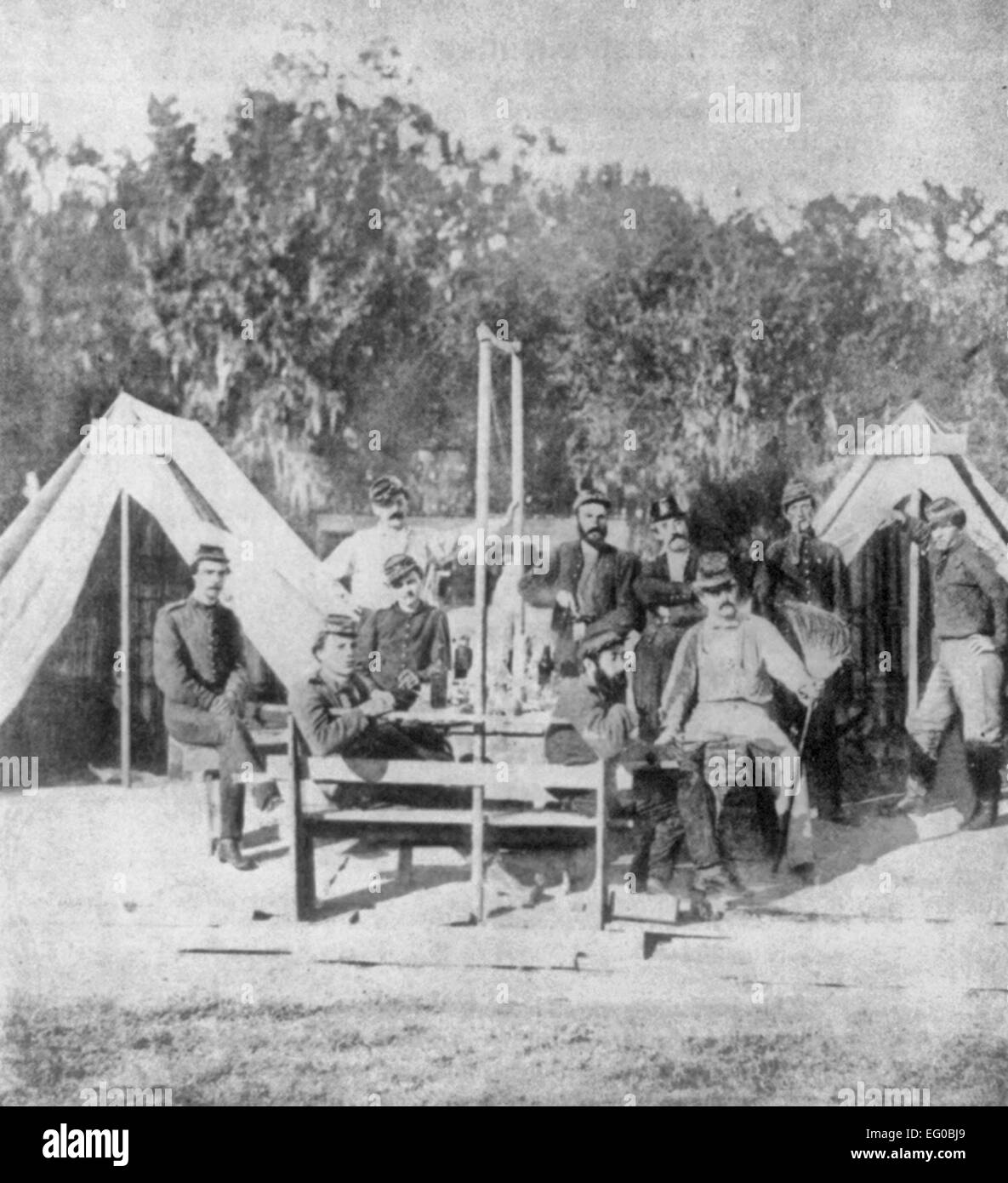 Confederate artillerists, members of the Washington Artillery Regiment of New Orleans, posed in front of tents. Stock Photo