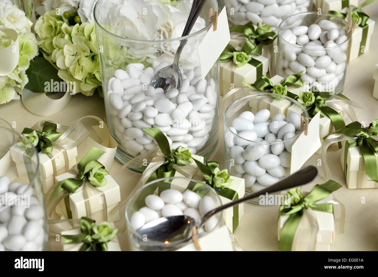 Sugared Almonds on Small Glasses and Small Gift Boxes - Stock Image
