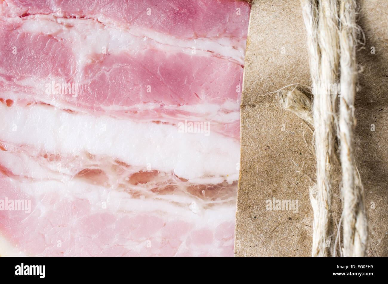 Smoked bacon in one piece of paper packaging - Stock Image