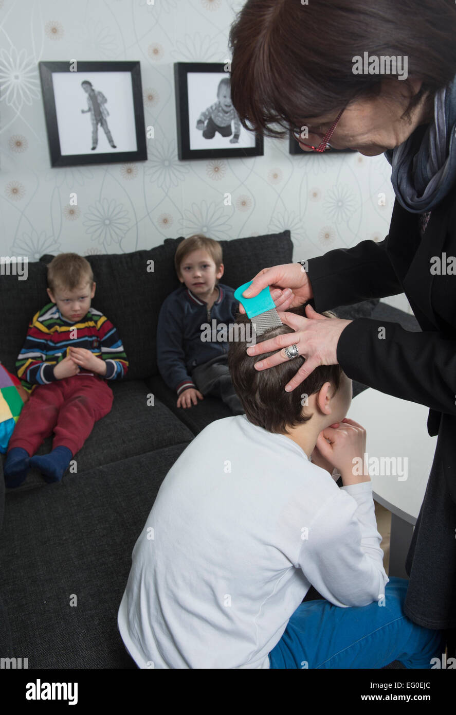 Mother checking childs hair for lice Stock Photo
