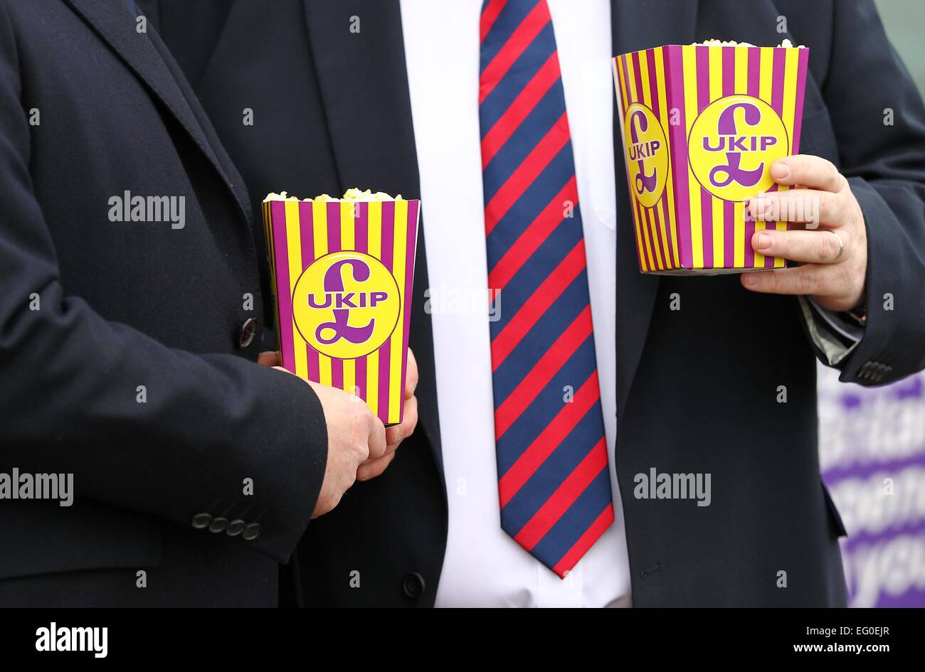 UK Independence Party members holding UKIP branded pop corn outside the Movie Starr Cinema in Canvery Island. - Stock Image