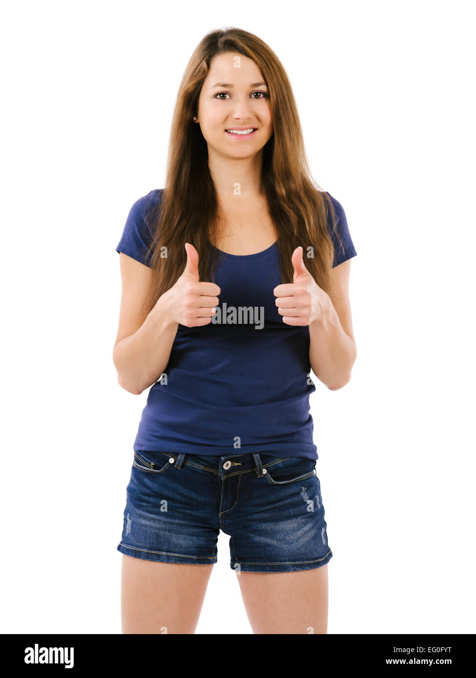 Photo of an happy young female doing the two thumbs up gesture over white background. - Stock Image