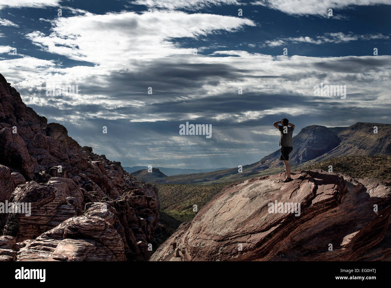 Man looking at distant landscape - Stock Image