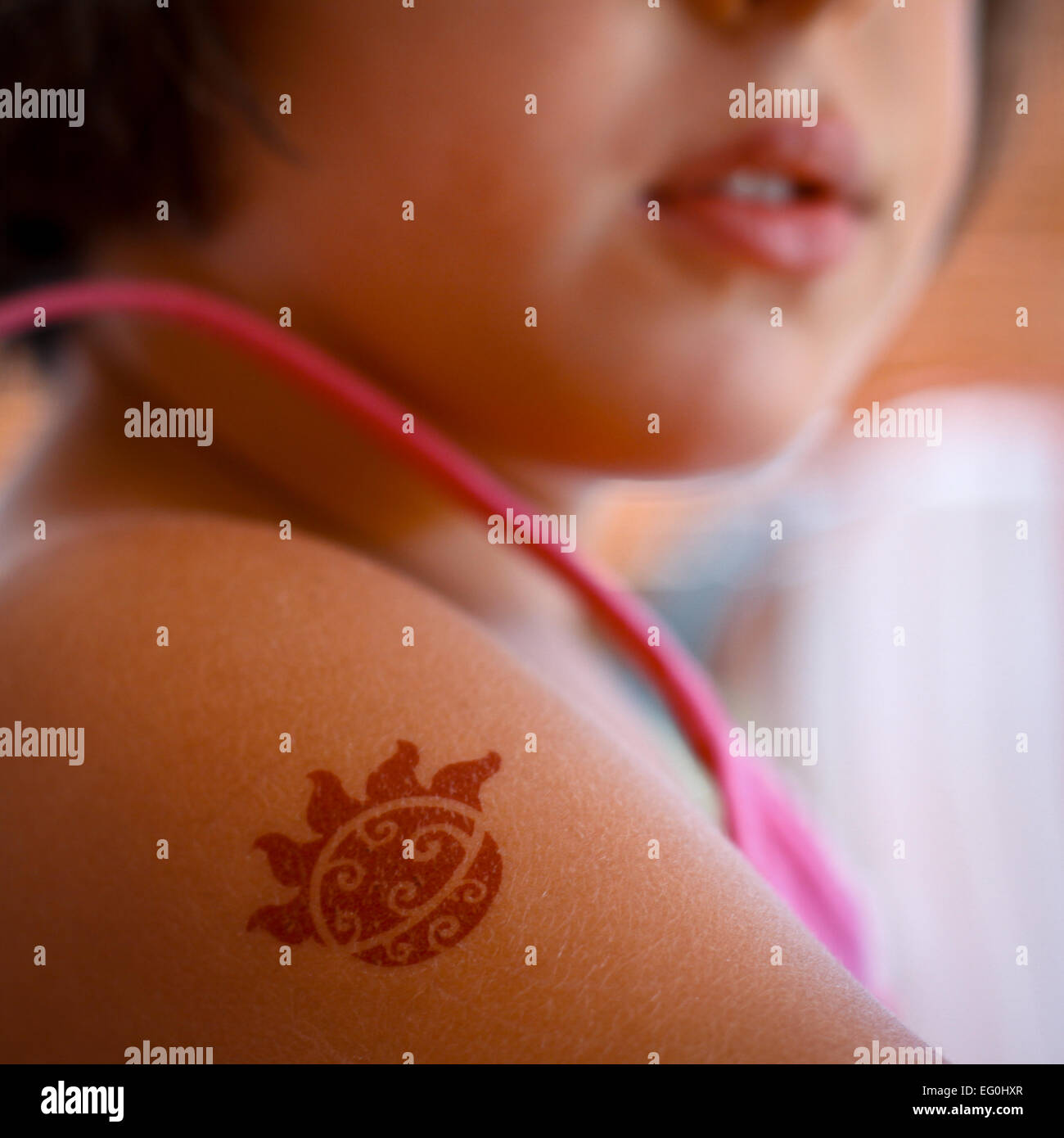 Girl (4-5) with fake tattoo - Stock Image