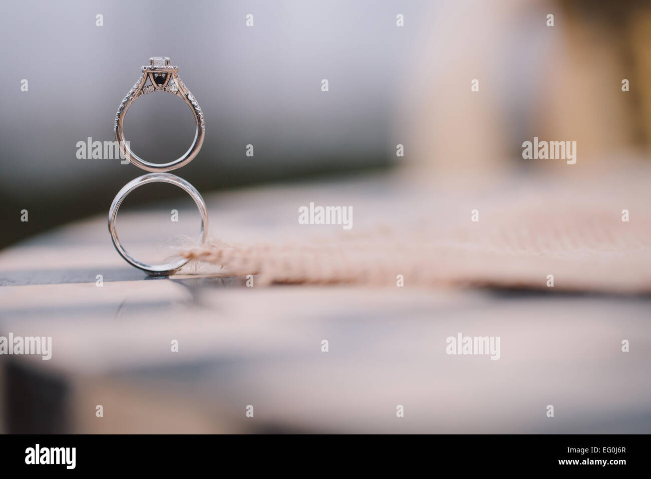 Wedding rings atop each other Stock Photo