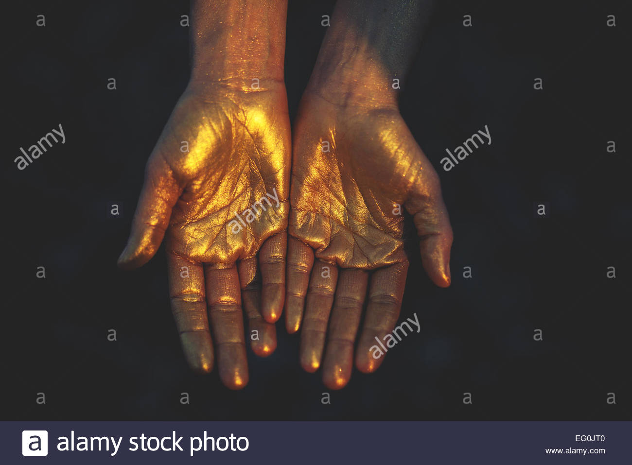 Close-up of woman's hands in cold color - Stock Image