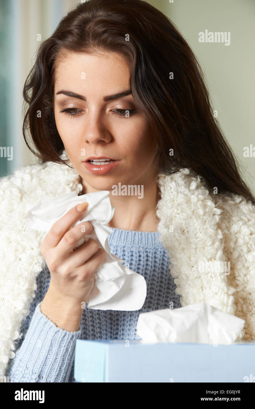 Woman With Cold Holding Tissue And Sneezing - Stock Image
